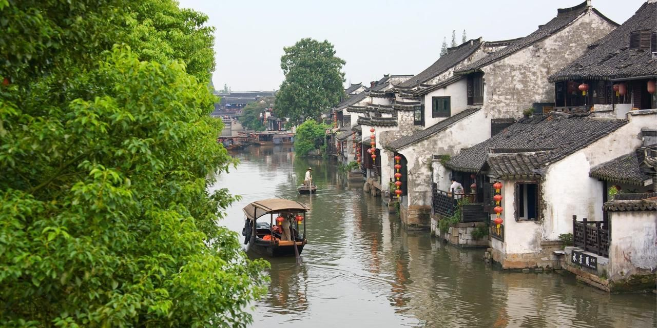 Ancient Chinese Town on the Banks of a River with a Boat on the Lake in China