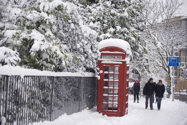 UK PHONE BOX IN THE SNOW