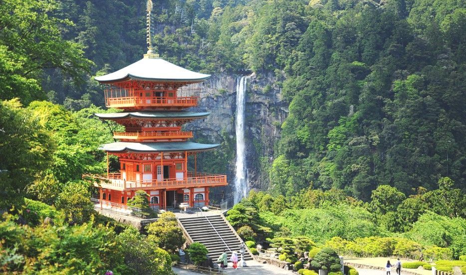 Japanese Temple in the Forest near to a Waterfall
