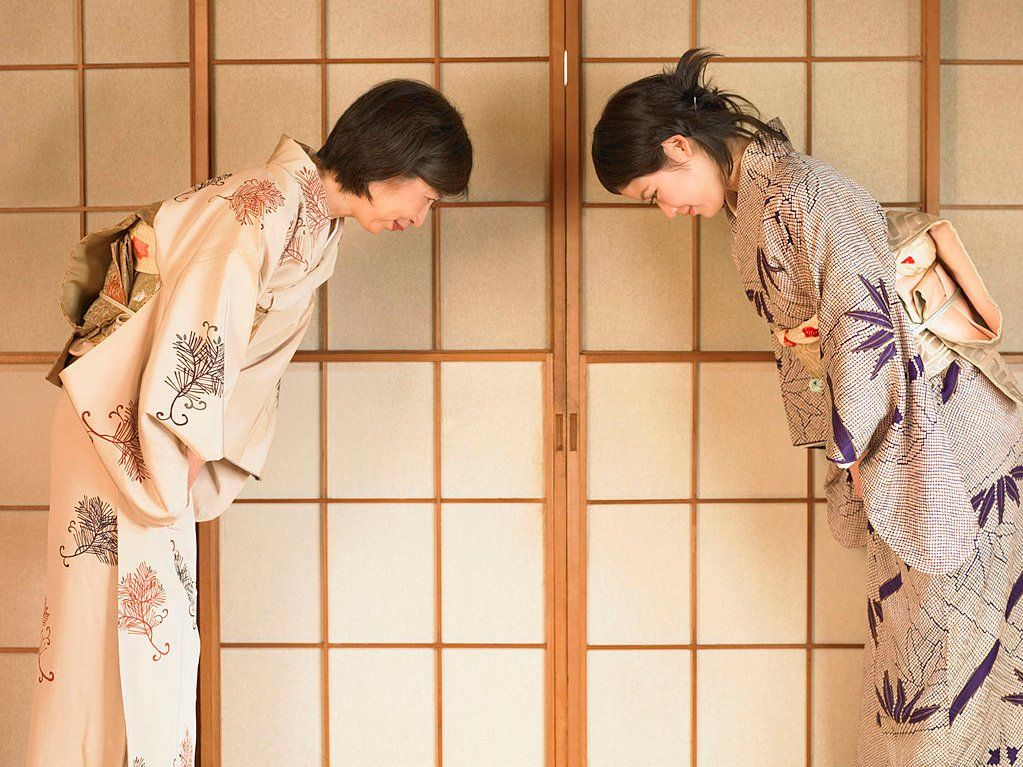 Two Girls Bowing the Japanese Way
