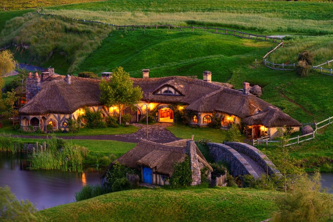 A Hobbit Village with a Bridge and a Lake in New Zealand