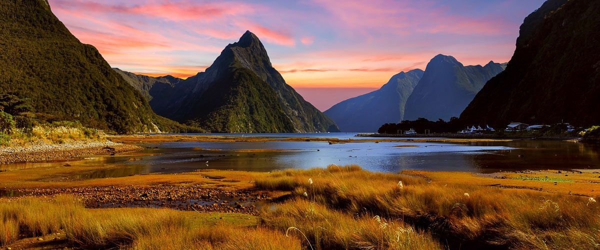Tourist Resort by a Lake by Mountain Peaks in New Zealand