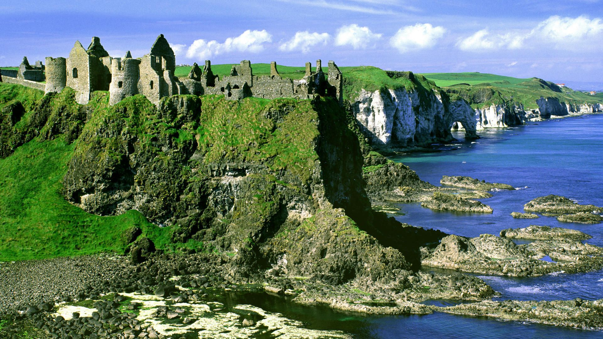 Ruined Castle on a Rock Face by the Sea